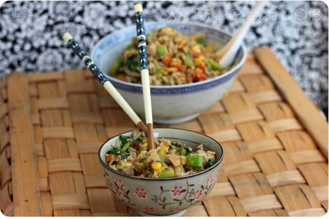Fried Rice in a bowl with chopsticks.
