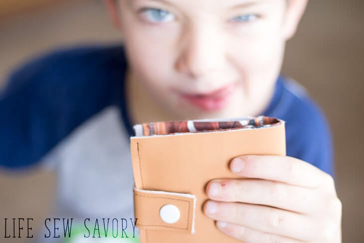 silly boy with wallet