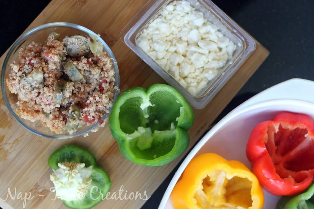Sausage Stuffed Peppers with Feta ingredients on a cutting board.