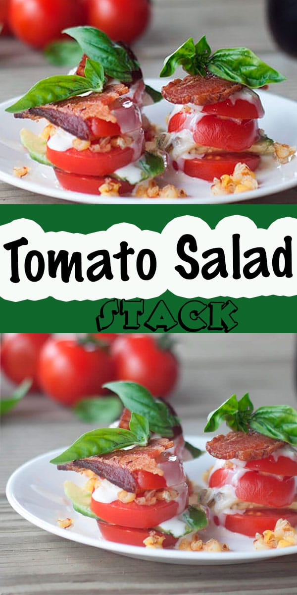 This tomato salad stack is beautiful and tasty. A gorgeous tomato salad with a stack of sliced and flavorful ingredients in each layer. Corn, bacon, dressing and basil make this a summer salad you don't want to miss. Add avocado for even more tasty flavors. via @lifesewsavory