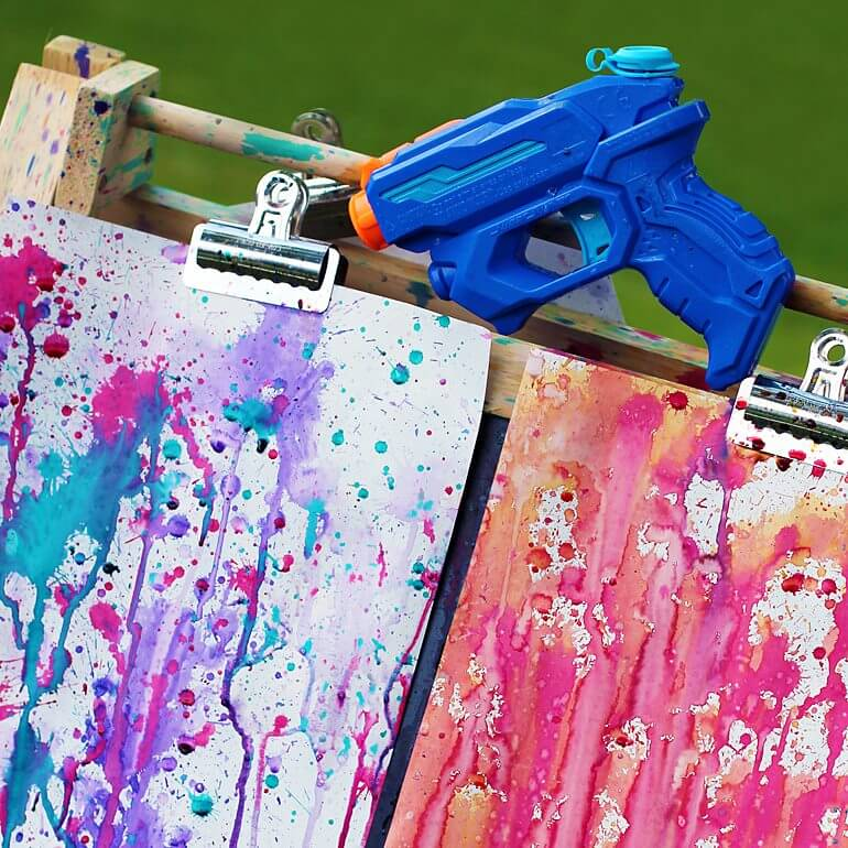 squirt gun painting for outdoor fun