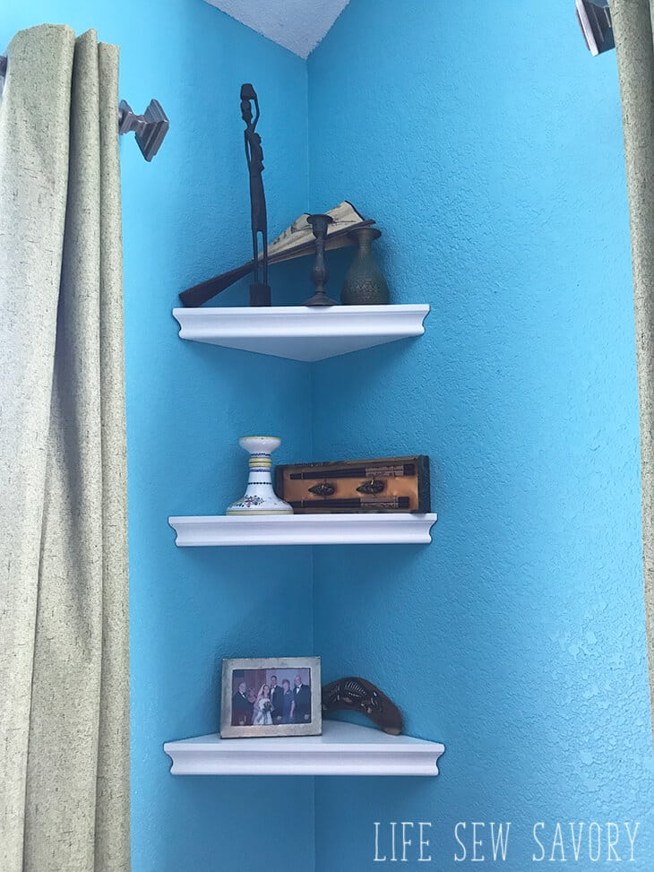 corner shelves in travel bedroom