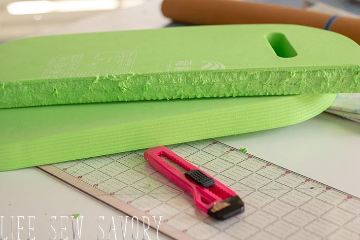 use a foam kickboard for knee pad