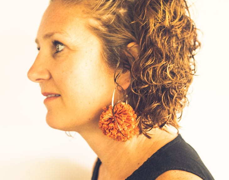 Large hoop pom pom earrings