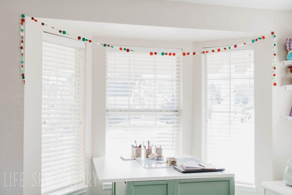 felt circle garland over work table christmas home tour