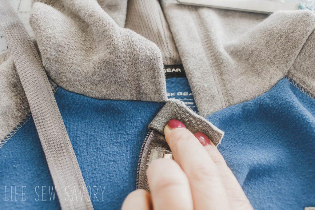 fold zipper tab