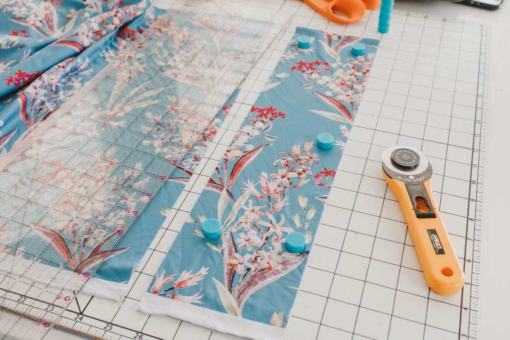 cutting fabric on mat