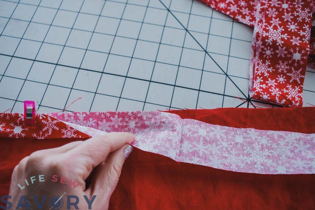 add binding to christmas apronng