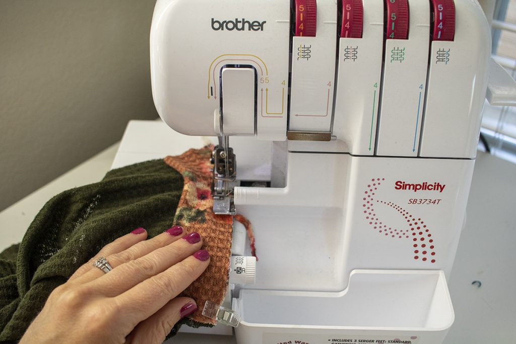 Sew cuff to sleeve with serger or stretch stitch