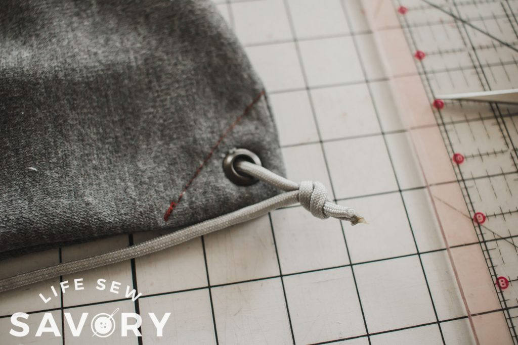 tie string through grommet to secure
