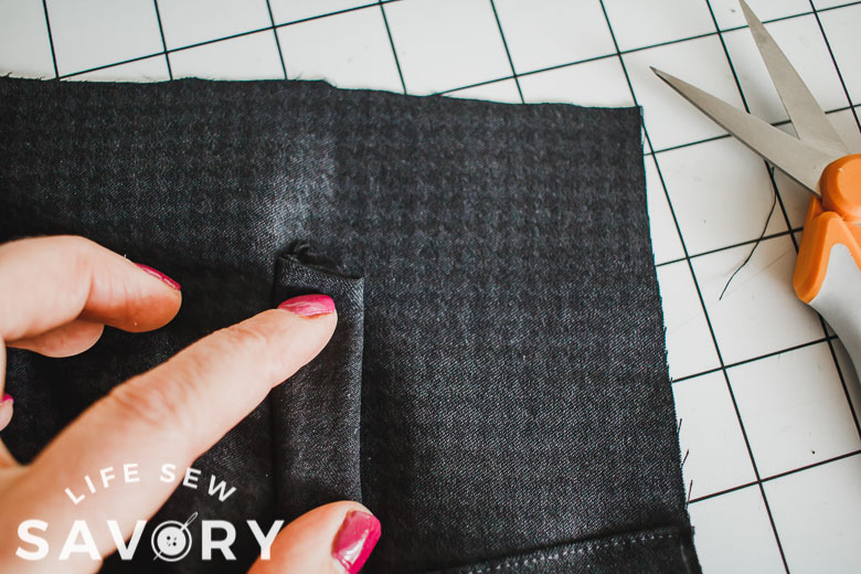 fold faux pocket up and sew sides to secure
