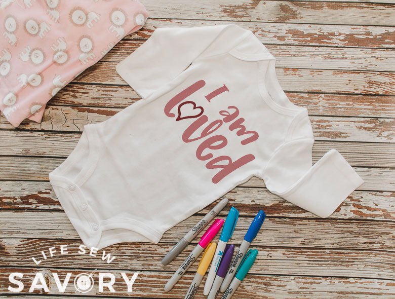 sign the baby onesie shower guest book