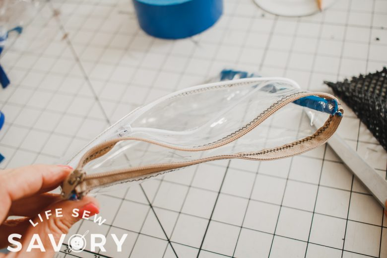 finish sides of pouch with tape or bias tape